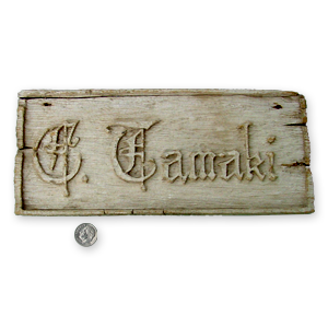 Hand carved name plate form Topaz Camp