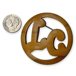 Carved wooden brooch with initials